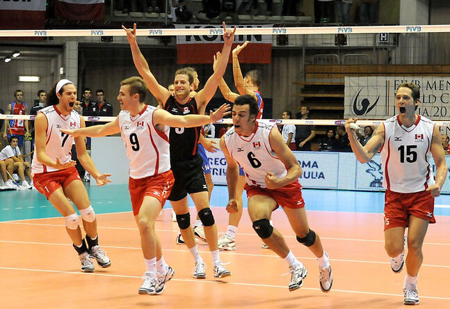 Brandon's Dustin Schneider (9) and his Canadian teammates celebrate an upset of Serbia in Trieste, Italy in September of 2010.