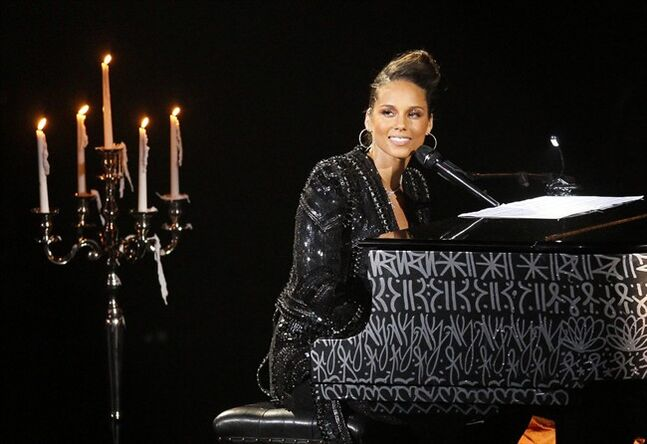 FILE - In this June 11, 2011 file photo, U.S. singer Alicia Keys plays piano as she performs during a concert at Hall of Congress in Paris. Dozens of actors and athletes are joining a U.S. government effort to support girls' education worldwide. Jennifer Garner, Keys, Anne Hathaway, DeAndre Jordan, Tyler Perry and Kelly Osborne are among the stars explaining the importance of education for girls around the globe in a video premiering Friday, June 20, 2014, for the new Let Girls Learn initiative. (AP Photo/Francois Mori, file)