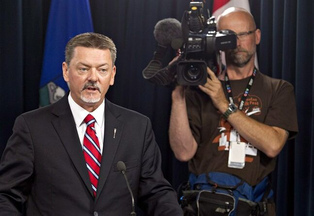 Doug Horner, Alberta Minister of Finance, speaks at a press conference in Edmonton on Aug. 7, 2014. The Alberta government says it plans to reduce its borrowing by almost $3 billion and is on track for a higher than expected surplus this fiscal year. Finance Minister Doug Horner says revenue is up due to higher energy forecasts and stronger corporate income taxes. THE CANADIAN PRESS/Jason Franson