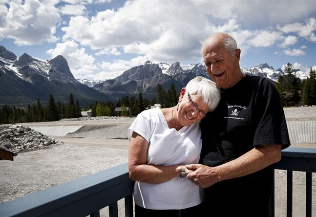 Paul Kutzer and his wife Marion are happy to have been able to save their once condemned home one year after a devastating flood in Canmore, Alta., Tuesday, June 3, 2014. THE CANADIAN PRESS/Jeff McIntosh