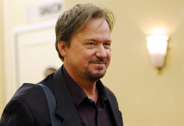 Frank Schaefer, a United Methodist Church pastor who was defrocked for officiating his son Tim's wedding to another man, arrives for a Methodist judicial panel appeal hearing of his defrocking in Linthicum, Md. Friday, June 20, 2014. Schaefer was the pastor of Zion United Methodist Church of Iona in Lebanon, Pa. (AP Photo/Steve Ruark)
