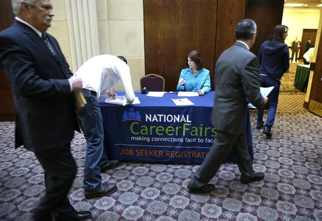 In this Wednesday, Jan. 22, 2014, photo, job seekers arrive to meet prospective employers during a career fair at a hotel in Dallas. The Labor Department reports on the number of people who applied for unemployment benefits for the third week of February on Thursday, Feb. 20, 2014. (AP Photo/LM Otero)