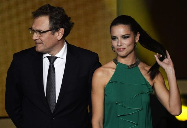 Brazilian super model Adriana Lima, right, and Jerome Valcke FIFA General Secretary, participate in the FIFA Ballon d'Or 2013 gala at the Kongresshaus in Zurich, Switzerland, Monday, Jan. 13, 2014. (AP Photo/Keystone, Steffen Schmidt)