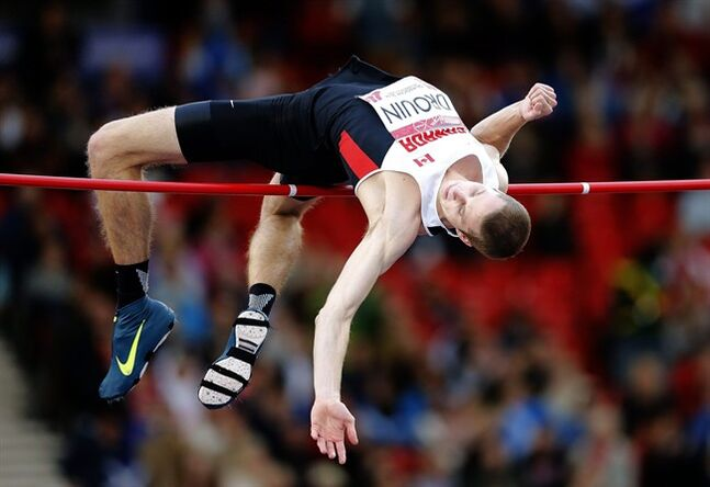 Canada's Derek Drouin jumps to win the Men's High Jmp competition at Hampden Park Stadium during the Commonwealth Games 2014 in Glasgow, Scotland, Wednesday July 30, 2014. (AP Photo/Frank Augstein)