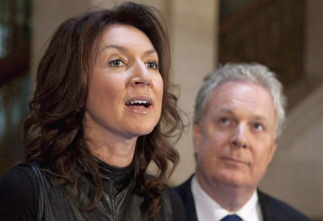 Quebec Deputy premier Nathalie Normandeau resigns as Quebec Premier Jean Charest looks on, on September 6, 2011 in Quebec City. Former Quebec deputy premier Nathalie Normandeau has received a subpoena from Quebec's corruption probe. THE CANADIAN PRESS/Jacques Boissinot