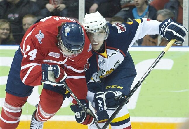 Barrie Colts defenceman Aaron Ekblad, right, battles for the puck against Oshawa Generals forward Sebastian Uvira, left, during first period OHL hockey action in Oshawa, Ont., on Monday, Feb. 20, 2012. From Ekblad down, this year's NHL draft is top heavy with Canadian-born talent.THE CANADIAN PRESS/Nathan Denette