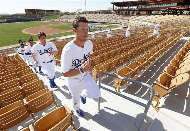 Los Angeles Dodgers pitcher Clayton Kershaw leads teammates running stairs during spring training baseball practice in Glendale, Ariz., Friday, Feb. 14, 2014. (AP Photo/Paul Sancya)
