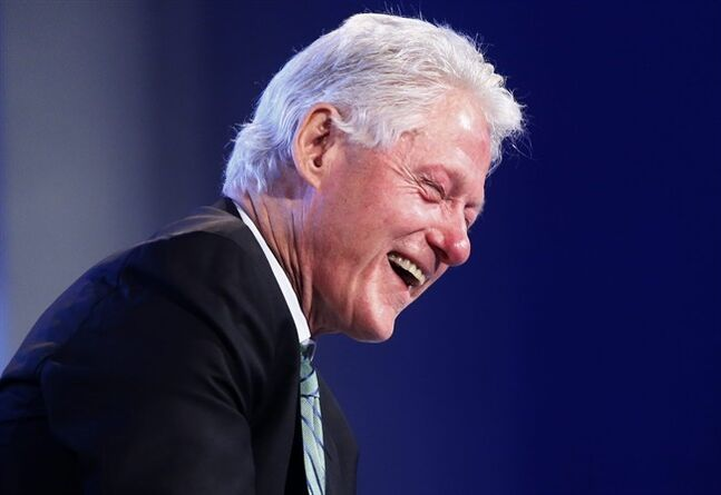 Former President Bill Clinton laughs as he answers a question from Gwen Ifill of PBS NewsHour regarding Republicans' questions regarding Hillary Rodham Clinton's head injury, Wednesday, May 14, 2014, at the 2014 Fiscal Summit organized by the Peter G. Peterson Foundation in Washington. Lawmakers and policy experts discussed America's long term debt and economic future. (AP Photo)