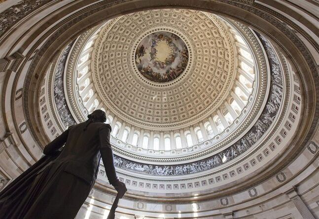 The Capitol Rotunda looms over the statue of George Washington on Capitol Hill in Washington, Monday, Jan. 27, 2014, as the House and Senate resume work in Washington. President Barack Obama will deliver his State of the Union address Tuesday night to a joint session of Congress. (AP Photo/J. Scott Applewhite)
