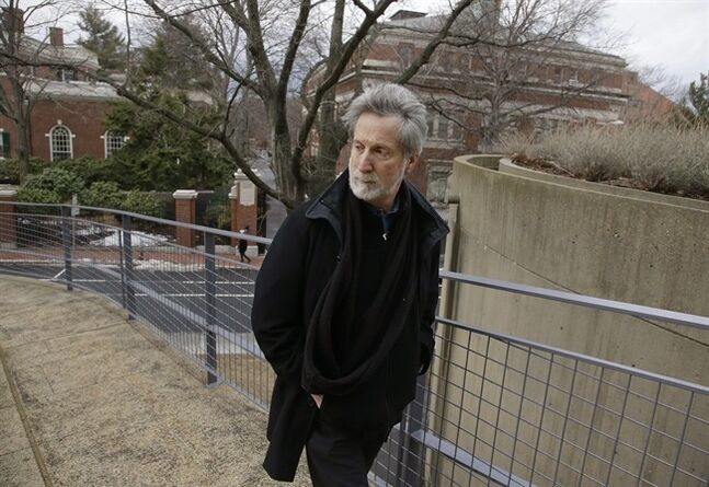In this Monday, Jan. 27, 2014 photo, film professor Robb Moss, who has taught for twenty-five years at Harvard, walks outside the Carpenter Center for the Visual Arts on the school's campus in Cambridge, Mass, Mass. Three filmmakers nominated separately for this year's Oscar for best feature documentary credit Moss for inspiring them to greatness. (AP Photo/Stephan Savoia)