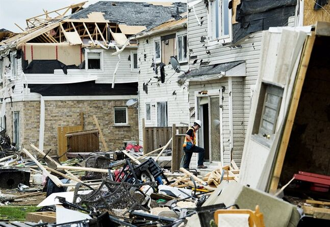 Investigators assess the damage to homes and property on Wednesday, June 18, 2014, a day after a tornado touched down in Angus, Ont . THE CANADIAN PRESS/Nathan Denette