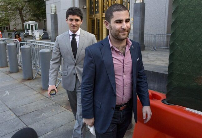 Charles Shrem, foreground, the top executive of a New York City-based Bitcoin company, walks from the federal court house in New York Thursday, Sept. 4, 2014, after pleading guilty to federal charges that he helped smooth the way for drug transactions on the online marketplace Silk Road. (AP Photo/Craig Ruttle)