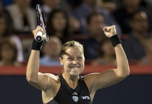 Shelby Rogers celebrates her victory over Eugenie Bouchard on Tuesday August 5, 2014 in Montreal. THE CANADIAN PRESS/Paul Chiasson