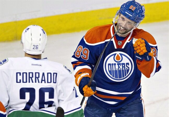 Edmonton Oilers Sam Gagner (right) is pictured in Edmonton, on September 21, 2013. Gagner was traded twice within 90 minutes Sunday night, first from the Edmonton Oilers to Tampa Bay and then from the Lightning to the Arizona Coyotes. THE CANADIAN PRESS/Jason Franson