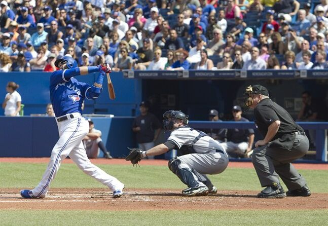 Toronto Blue Jays' Jose Bautista hits a two run home run in the first inning of their AL baseball game against the New York Yankees in Toronto on Saturday, August 30, 2014. THE CANADIAN PRESS/Fred Thornhill