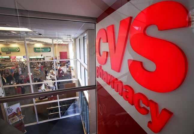 FILE - In this Nov. 3, 2009 file photo, a CVS pharmacy sign is displayed at a CVS in Providence, R.I. CVS Caremark Corp. reports quarterly earnings on Tuesday, Feb. 11, 2014. (AP Photo/Steven Senne, File)
