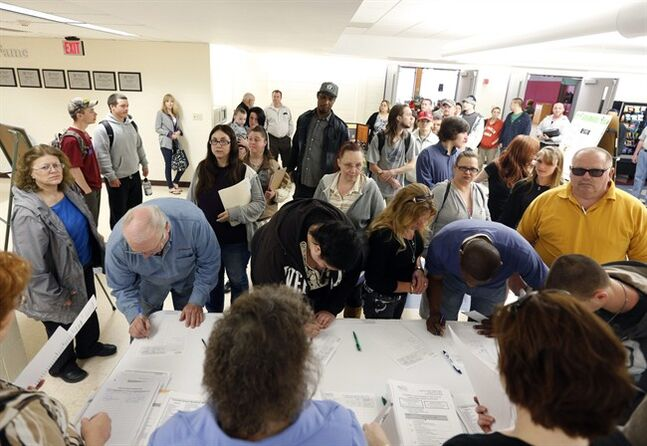 FILE - In this April 22, 2014 file photo, job seekers line up for a job fair at Columbia-Greene Community College in Hudson, N.Y. A far more durable U.S. economy has emerged from the wreckage of the Great Recession. And_tragically_ that has been a problem for the now five-year recovery. (AP Photo/Mike Groll, File)