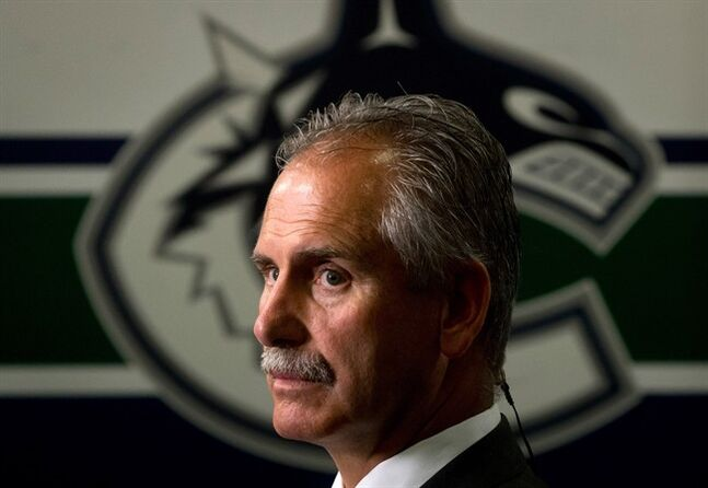 Vancouver Canucks' head coach Willie Desjardins stands for television interviews after he was hired by the NHL hockey team in Vancouver, B.C., on Monday June 23, 2014. Desjardins replaces John Tortorella who was fired at the end of last season. THE CANADIAN PRESS/Darryl Dyck
