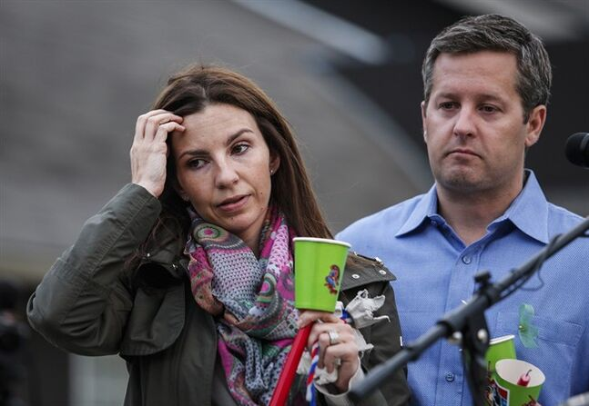 Rod O'Brien, and Jennifer O'Brien attend a candlelight vigil for missing Calgarians Nathan O'Brien, five, and his grandparents Alvin and Kathryn Liknes in Calgary, Alta., Thursday, July 10, 2014.THE CANADIAN PRESS/Jeff McIntosh