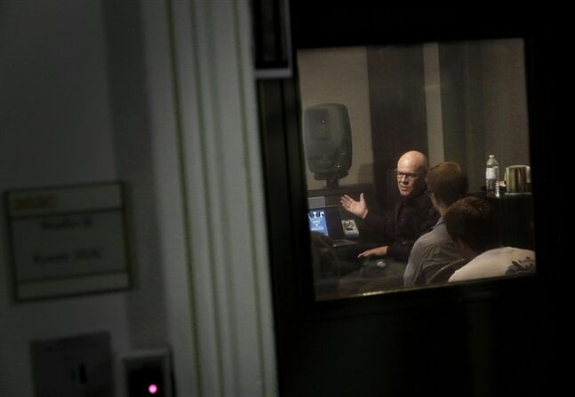 In this Aug. 29, 2014 picture, musician Thomas Dolby is seen through a recording studio window as he speaks with students in his class,