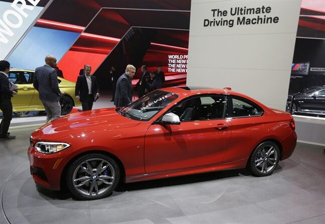 FILE - In this Jan. 13, 2014, file photo, the BMW M235i is unveiled at the North American International Auto Show in Detroit. The M235i, which is the top of BMW's new 2-Series model line, is being compared by some to BMW's revered 2002tii from the 1970s. (AP Photo/Carlos Osorio, File)