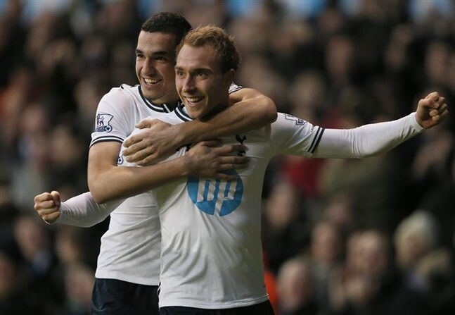 Tottenham's Christian Eriksen, right, celebrates after scoring a goal against Crystal Palace during their English Premier League soccer match at the White Hart Lane stadium in London, Saturday, Jan. 11, 2014. 2014. (AP Photo/Alastair Grant)