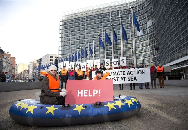 Protestors from Friends of the Earth hold up cards which read out 'Climate SOS' during a demonstration outside EU headquarters in Brussels on Wednesday, Jan. 22, 2014. THE CANADIAN PRESS/AP, Virginia Mayo