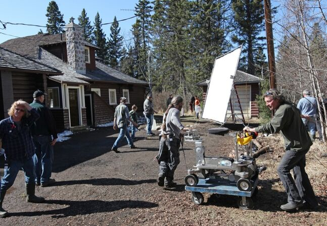 Crew members work to set up a scene during filming of the movie Hunting Season at Clear Lake Golf Course on Tuesday afternoon.