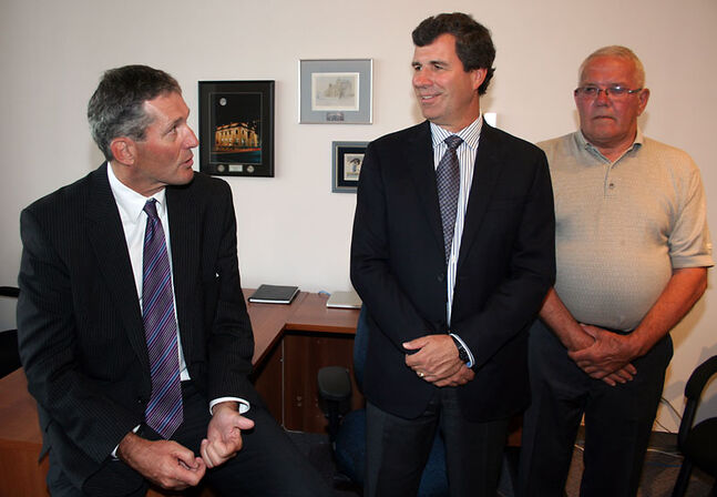 Progressive Conservative Leader Brian Pallister (left) chats with Brandon West MLA Reg Helwer and Ste. Rose MLA Stuart Briese at Helwer's Brandon office during Pallister's tour through southern Manitoba on Thursday.