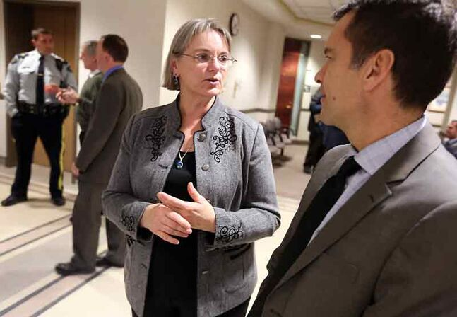 Provincial Court Judge Krystyna Tarwid chats with Manitoba Chief Justice Kenneth Champagne during a reception on Thursday at the Brandon Courthouse to mark her upcoming retirement.