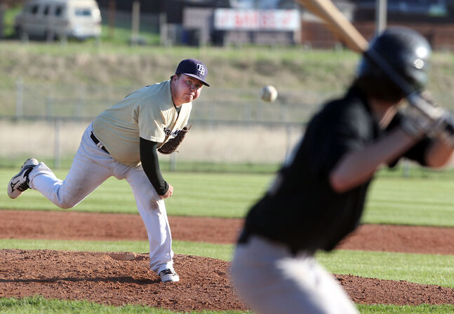 Dillon Johnston hurls a pitch for the Diamond Dawgs in their Andrew Agencies Senior AA baseball game with Young Guns on Tuesday.