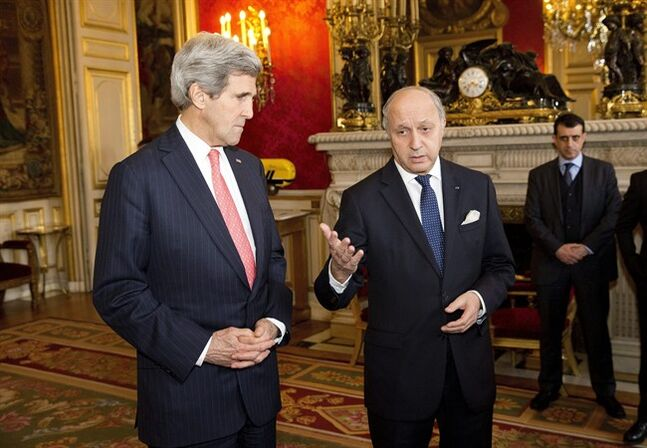French Foreign Minister Laurent Fabius, right, gestures during a statement on the violence in Ukraine before a meeting with Secretary of State John Kerry, left, on Wednesday, Feb. 19, 2014, in Paris. (AP Photo/ Evan Vucci, Pool)