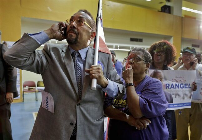 Supporters for Rep. Charles Rangel, D-N.Y. watch election returns during a primary election night gathering, Tuesday, June 24, 2014, in New York. Rangel is seeking his 23rd term against opponent state Sen. Adriano Espaillat. (AP Photo/Julie Jacobson)