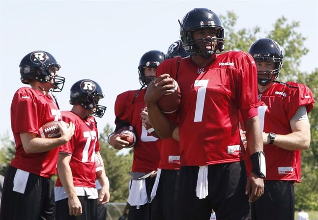 Ottawa Redblacks quarterback Henry Burris (#1) watches the first day of CFL training camp with teammates at Keith Harris Stadium in Ottawa on Sunday, June 1, 2014. THE CANADIAN PRESS/ Patrick Doyle