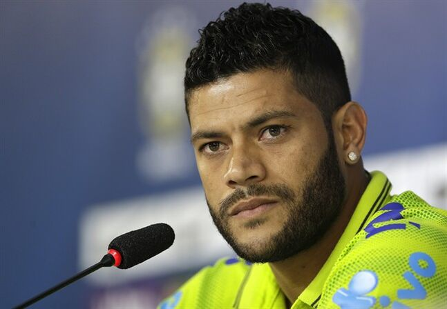 Brazil's Hulk listens to questions from the media during a news conference after a training session of the Brazilian national soccer team at the Granja Comary training center in Teresopolis, Brazil, Sunday, June 15, 2014. Brazil plays in group A of the 2014 soccer World Cup. (AP Photo/Andre Penner)
