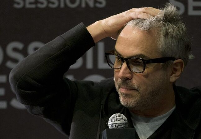 FILE - In this April 30, 2014 file photo, Oscar-winning Mexican film director Alfonso Cuaron responds to a question during a press conference in Mexico City. Cuaron published another full-page newspaper ad in Mexican newspapers on Monday, May 5, 2014 asking the president for a series of public debates on reforms to the country's state-owned oil industry. (AP Photo/Rebecca Blackwell, File)