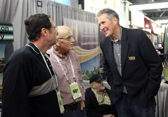 Progressive Conservative Party of Manitoba Leader Brian Pallister mingles with reps during Manitoba Ag Days at the Keystone Centre in Brandon on Tuesday.