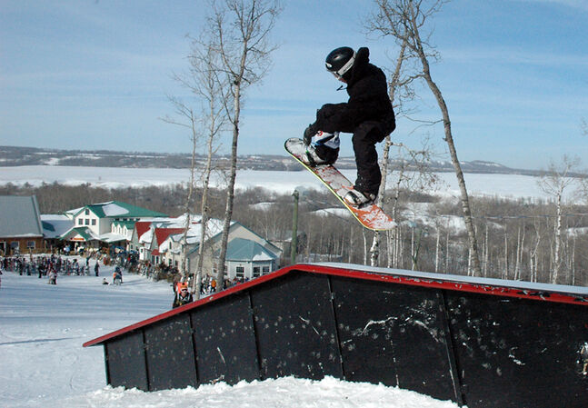 A young Mark McMorris competes in the rails competition in Asessippi in 2008. Despite his age, McMorris, who won bronze in the slopestyle snowboarding event at the Winter Olympics in Sochi, Russia, was one of the best on the hill.