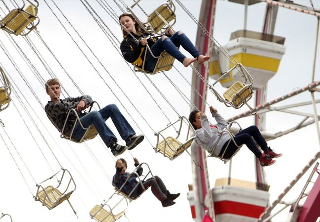 Fairgoers take a ride on the swings during the opening day of the Manitoba Summer Fair, Wednesday afternoon at the Keystone Centre.