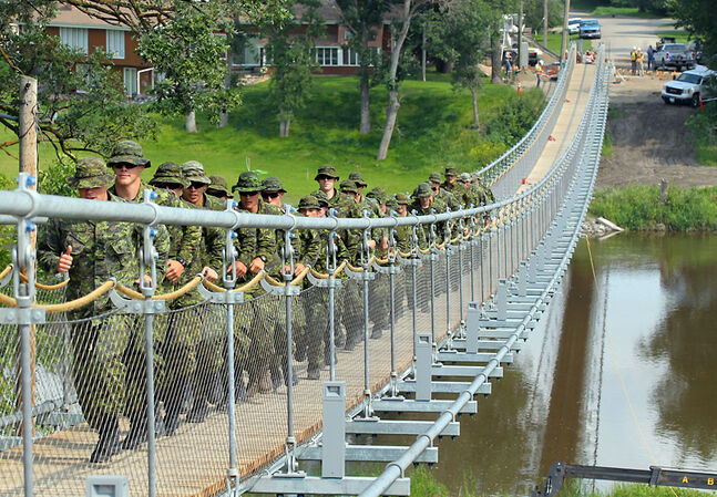 Soldiers with the 2nd Battalion, Princess Patricia's Canadian Light Infantry group march over the newly constructed Souris Swinging Bridge in August 2013. Three years after the flood of 2011 demolished the iconic structure, the town is hosting the Souris Still Swinging' Weekend starting tonight. The four-day event includes a concert, bridge dedication ceremony, scavenger hunt and fireworks.