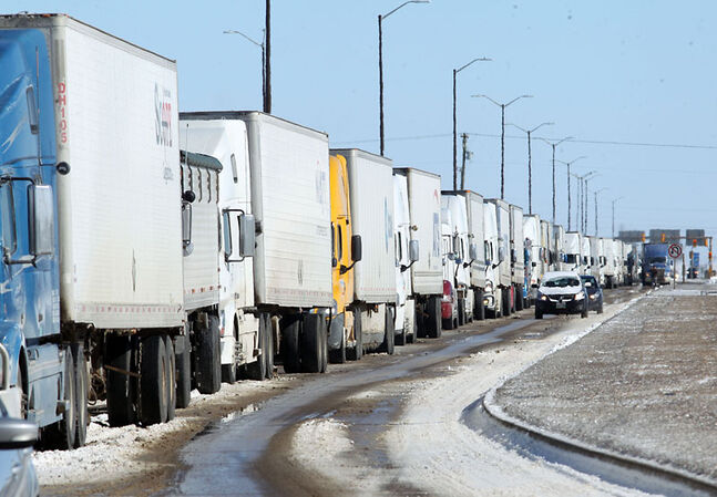 Long lines of transport trucks line the Trans-Canada Highway between First Street and Eighteenth Street while awaiting the re-opening of the highway westbound towards the Saskatchewan border. Westman banded together to brave a storm that shut down the area.