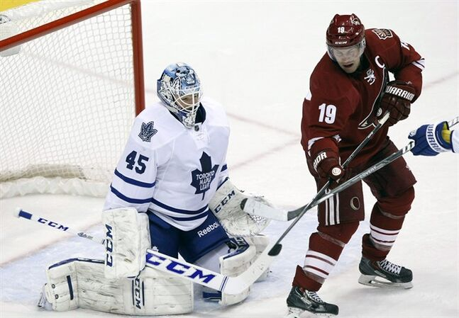 Toronto Maple Leafs goalie Jonathan Bernier (45) makes the save on Phoenix Coyotes right wing Shane Doan (19) in the second period of an NHL hockey game, Monday, Jan. 20, 2014, in Glendale, Ariz. (AP Photo/Rick Scuteri)