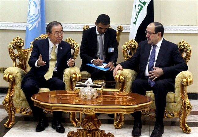 U.N. chief Ban Ki-moon, left, speaks with Iraqi Prime Minister Nouri al-Maliki during a meeting in Baghdad, Iraq, Thursday, July 24, 2014. The UN chief is expected to urge politicians there to form a new government quickly. Al-Maliki is facing growing calls for his resignation as disgruntled Sunnis say they do not believe he will give them a greater voice in the government. (AP Photo/Ahmad Al-Rubaye, Pool)