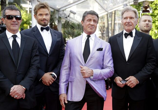 From left, actor Antonio Banderas, Kellen Lutz, Sylvester Stallone, and Harrison Ford, the cast of The Expendables 3, pose on the red carpet as they arrive for the screening of The Homesman at the 67th international film festival, Cannes, southern France, Sunday, May 18, 2014. (AP Photo/Thibault Camus)