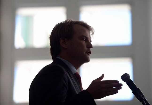 Immigration Minister Chris Alexander speaks during an event in Ottawa on June 20, 2014. The Conservative government has another legal battle on its hands after the Federal Court ruled against controversial reductions to health-care coverage for refugee claimants. Citizenship and Immigration Minister Chris Alexander says the government will appeal Friday's decision by Justice Anne Mactavish, which denounced the cuts as