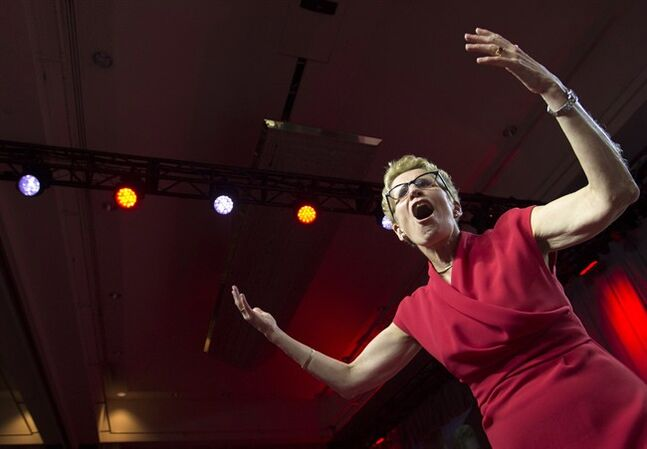 Ontario Liberal Leader Kathleen Wynne celebrates with supporters at the Liberal's election night headquarters in Toronto, Ont. on Thursday, June 12, 2014. THE CANADIAN PRESS/Darren Calabrese
