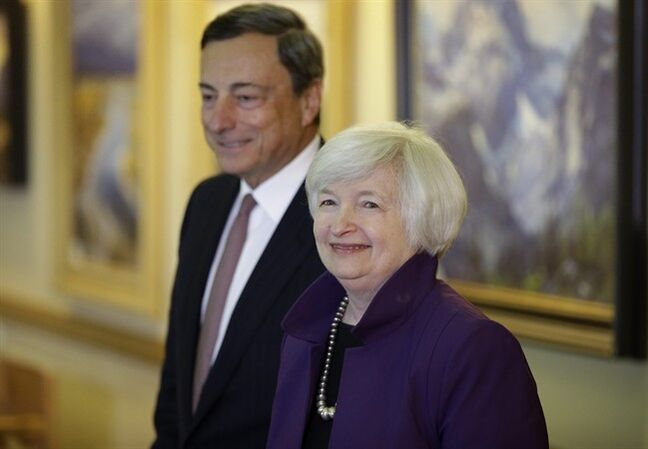 Federal Reserve Chair Janet Yellen, right, and European Central Bank President Mario Draghi walk together during the Jackson Hole Economic Policy Symposium at the Jackson Lake Lodge in Grand Teton National Park near Jackson, Wyo. Friday, Aug. 22, 2014. (AP Photo/John Locher)