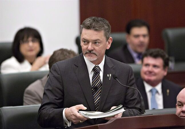 Albert President of Treasury Board and Minister of Finance Doug Horner delivers the budget in Edmonton, Alberta on Thursday March 6, 2014. Horner says he won't seek the leadership of the governing Progressive Conservatives. THE CANADIAN PRESS/Jason Franson