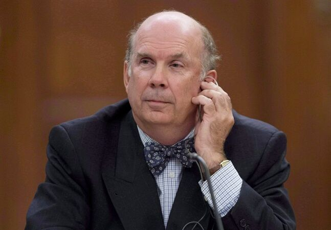 Justice Marc Nadon listens to opening remarks as he appears before a parliamentary committee following his nomination to the Supreme Court of Canada on Parliament Hill in Ottawa on October 2, 2013. The association that represents lawyers in Canada is calling on Prime Minister Stephen Harper to acknowledge the chief justice of the Supreme Court has done nothing wrong. The Canadian Bar Association says it's deeply concerned about the public spat between Harper and Beverely McLachlin. THE CANADIAN PRESS/Adrian Wyld