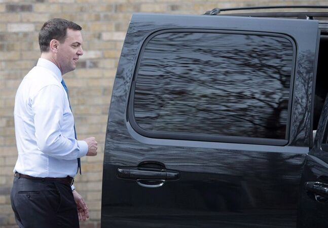 Ontario PC Leader Tim Hudak gets into his SUV in Burlington on Wednesday, May 7, 2014. THE CANADIAN PRESS/Darren Calabrese
